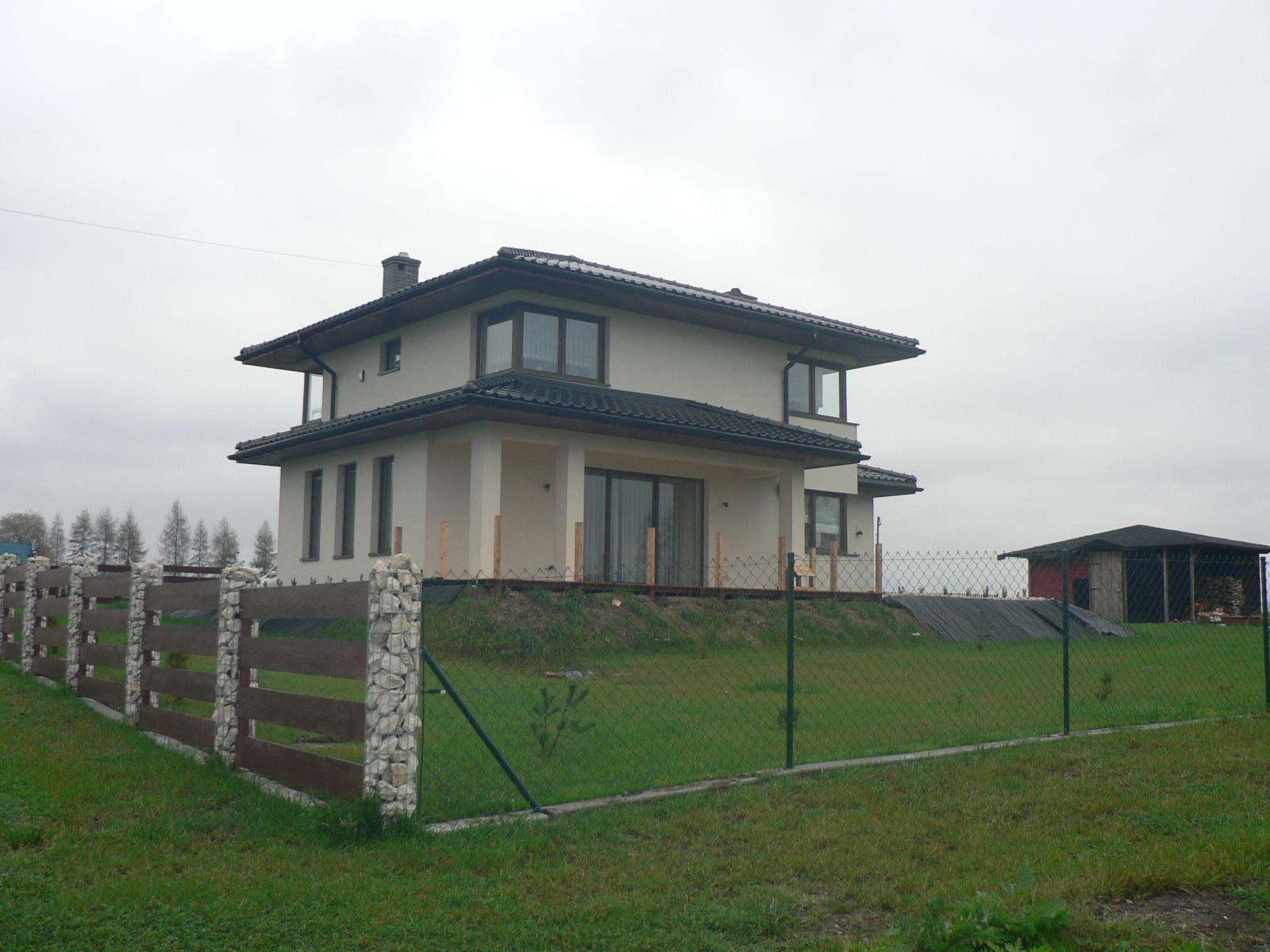 Строительство двухэтажного дома, площадью 224 м2 в стиле прерий, вид сзади